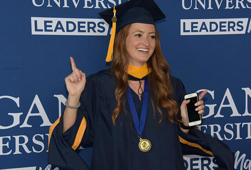Female student smiling at graduation.