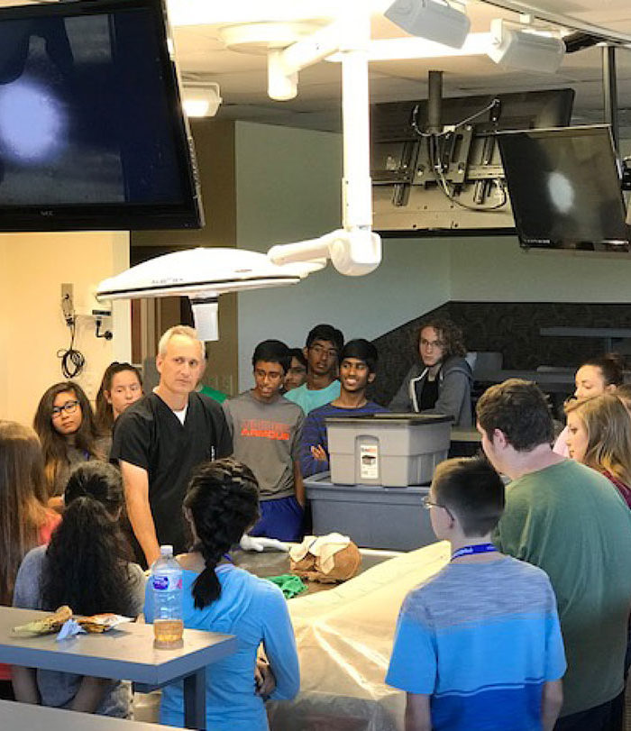 Instructor teaching in cadaver lab.