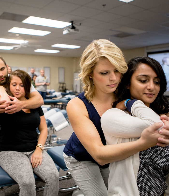 Students practicing techniques on each other in class.