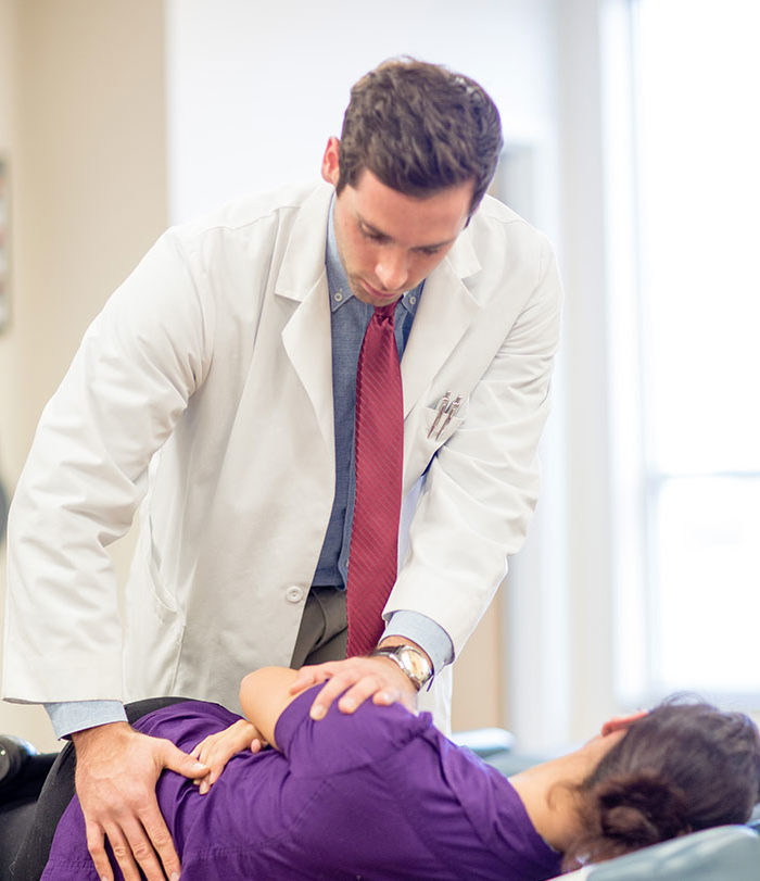 Chiropractic student working on patient.