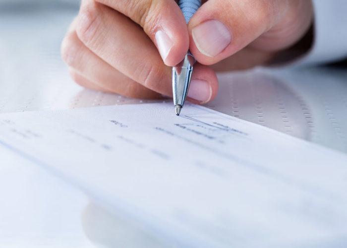 Hand writing a check.