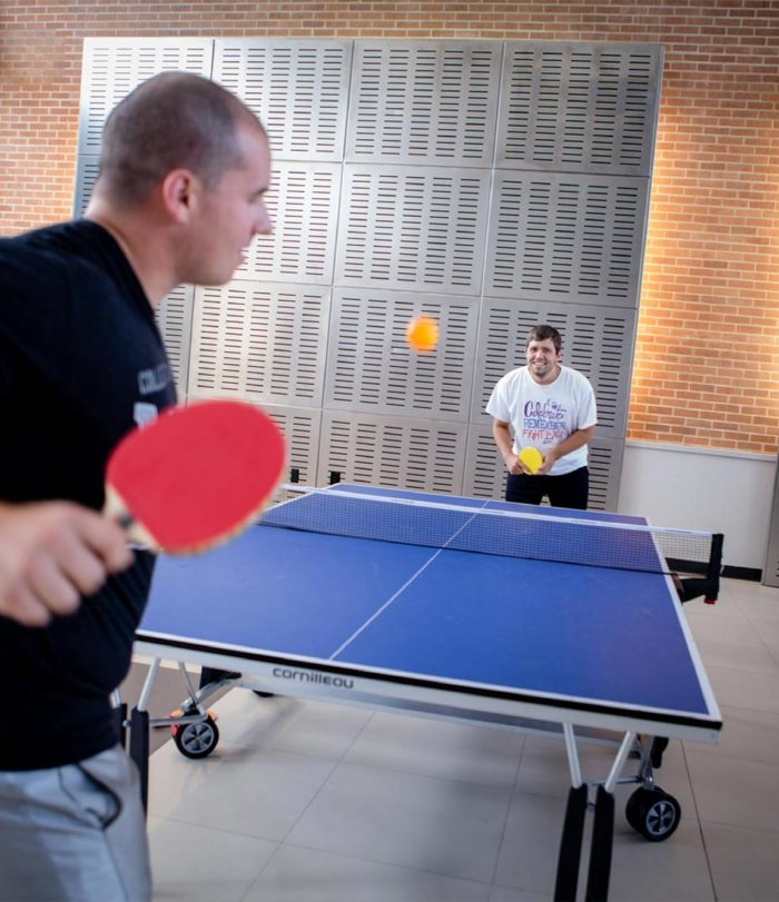 Students playing ping pong.