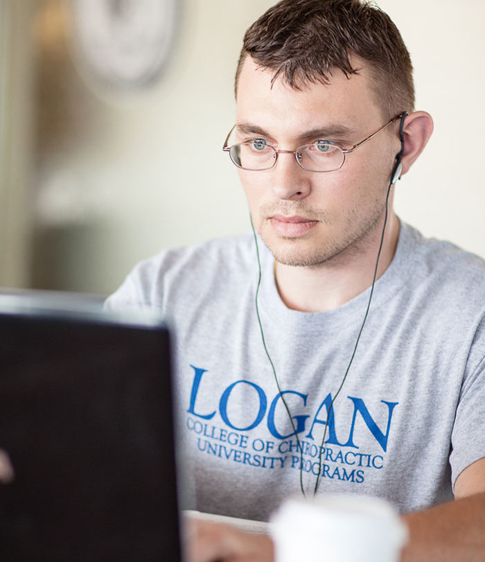 Male student working on a computer.