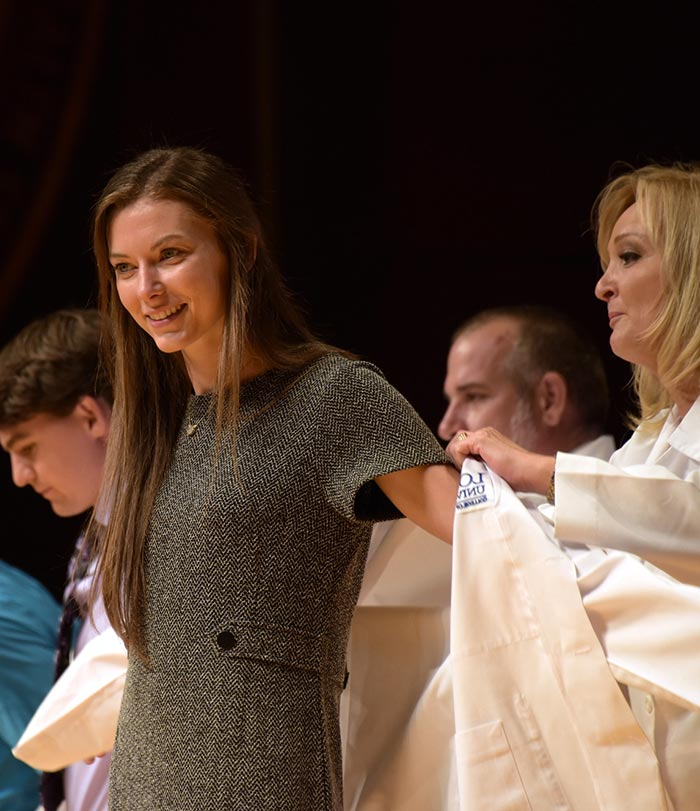 Female student at White Coat Ceremony.