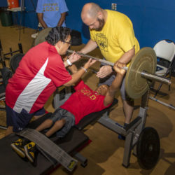 Two USAPP coaches working with young athlete.