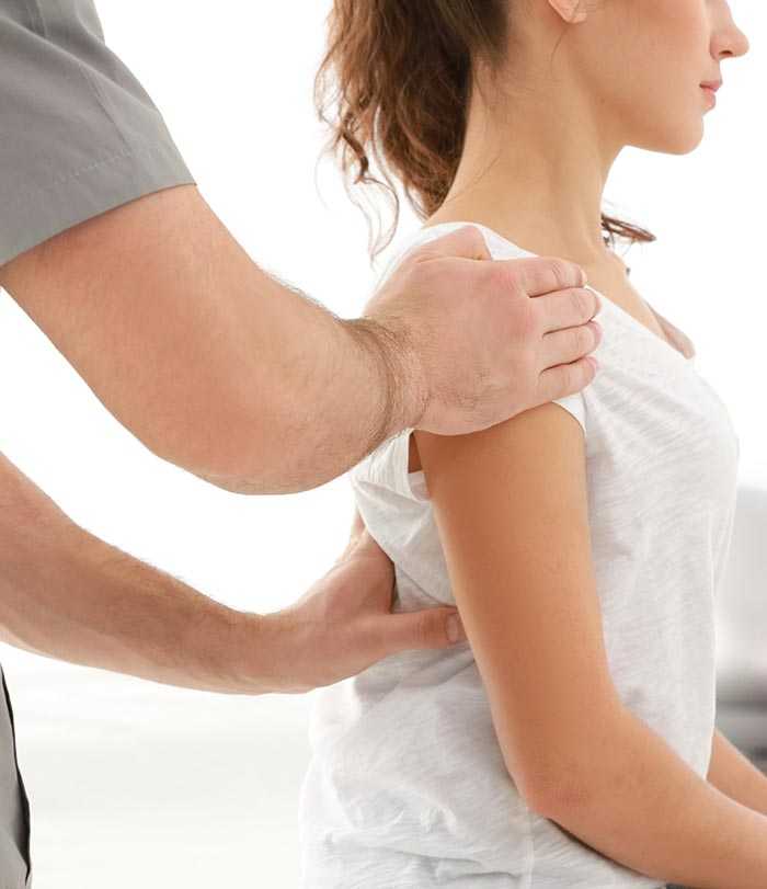 Female being adjusted by a chiropractor.
