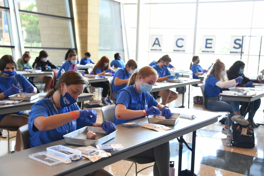 High school students learn about suturing at Logan University's fourth annual Anatomy Centered Education and Science Workshop