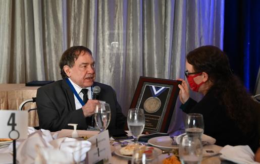 Dr. Norman Kettner gives brief remarks after receiving the inaugural Spirit of Logan Distinguished Alumni Award.